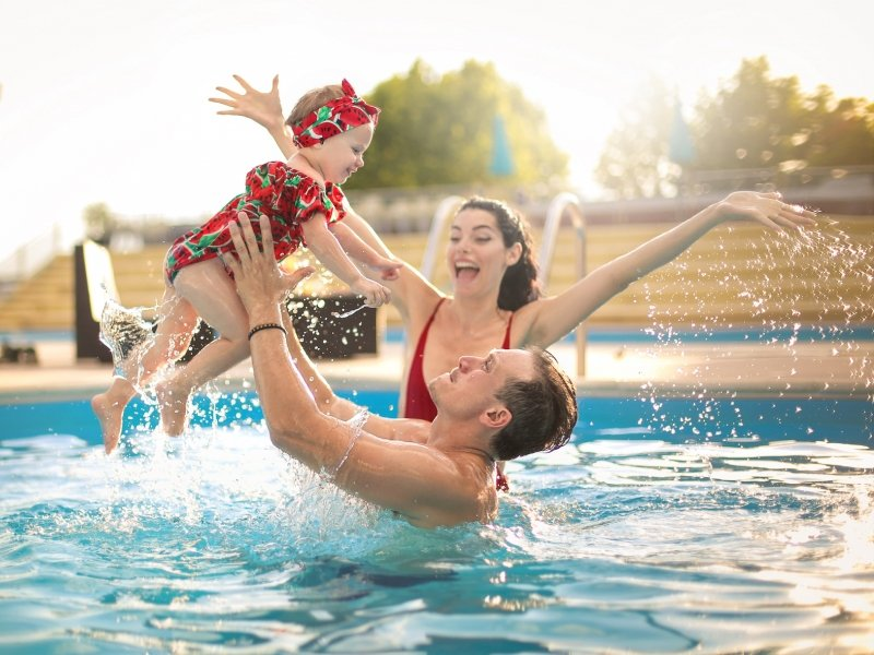 family-swimming-in-a-pool