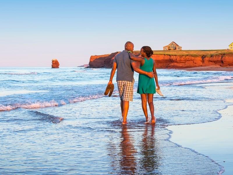Sea View Beach, couple walking, back view, waves