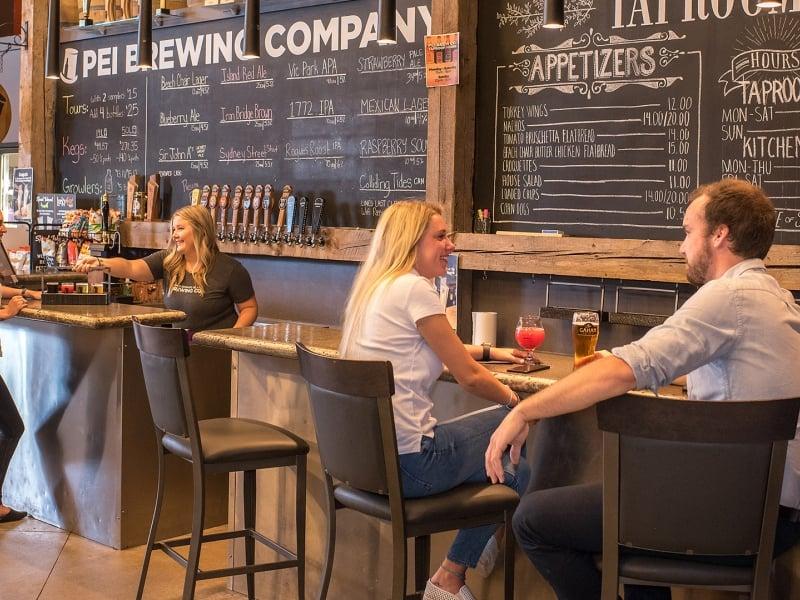 PEI Brewing Company, bar, people sitting, beer, chalkboard menu