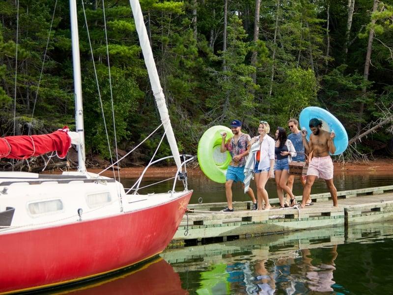Boat, group of people, docks, inner-tubes